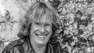 Black and white portrait of Keith Emerson smiling