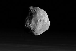 European Probe Swings Close by Martian Moon