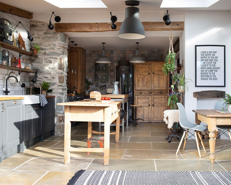 stone flooring in country style kitchen with open plan living and grey kitchen - CREDIT Katie Lee