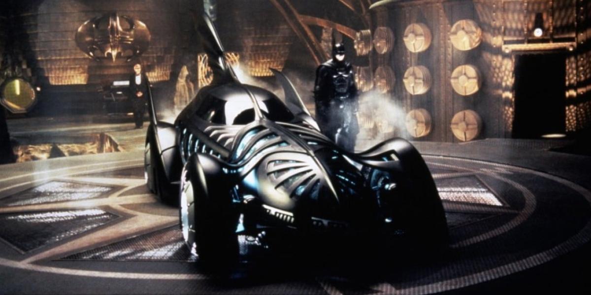 Val Kilmer next to his Batmobile in Batman Forever