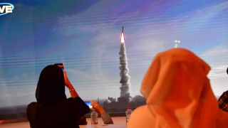 "A picture taken on July 19, 2020, shows a screen broadcasting the launch of the ""Hope"" Mars probe at the Mohammed Bin Rashid Space Center in Dubai."