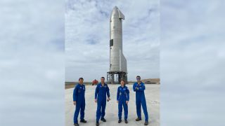 NASA astronauts (from left to right) Michael Barratt, Reid Wiseman, Christina Koch and Matthew Dominick stand in front of SpaceX's Starship SN11 prototype in South Texas. Koch posted this photo on Twitter on March 23, 2021.