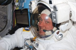NASA astronaut Michael Fincke, STS-134 mission specialist, attired in an Extravehicular Mobility Unit (EMU) spacesuit, is pictured in the Quest airlock of the International Space Station prior to the start of the mission's third spacewalk on May 25, 2011.