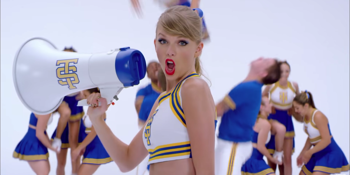 Taylor Swift in cheerleading outfit in Shake It Off music video
