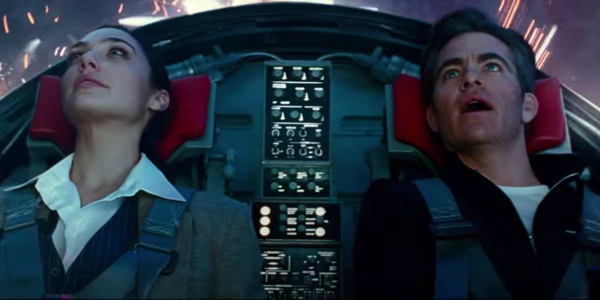 Wonder Woman 1984 Gal Gadot and Chris Pine marveling at fireworks in the invisible jet