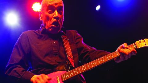 Wilko Johnson playing an electric guitar onstage.