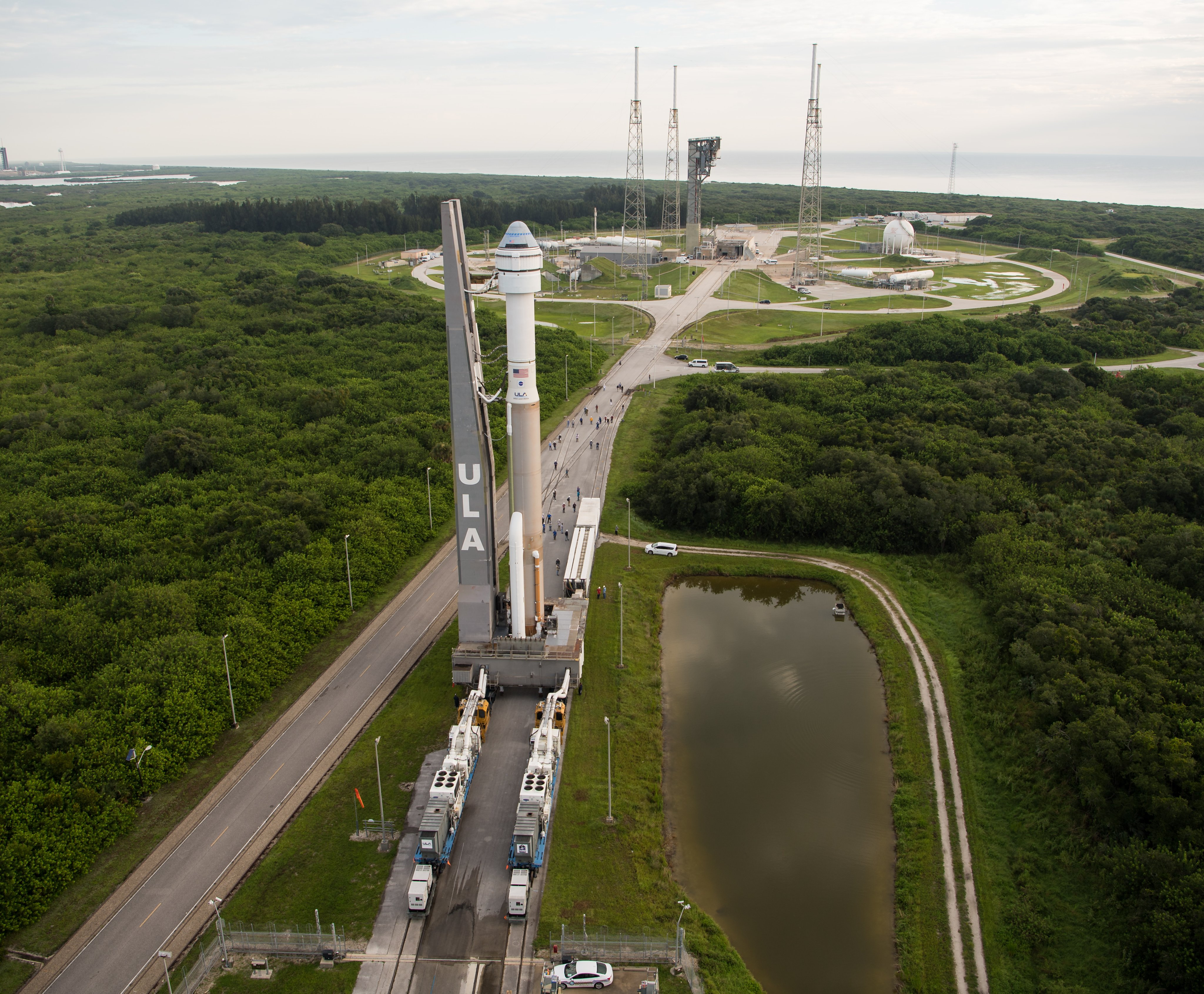 Boeing's Starliner capsule and its United Launch Alliance Atlas V rocket roll out to their launch pad at Cape Canaveral Space Force Station on Aug. 2, 2021.