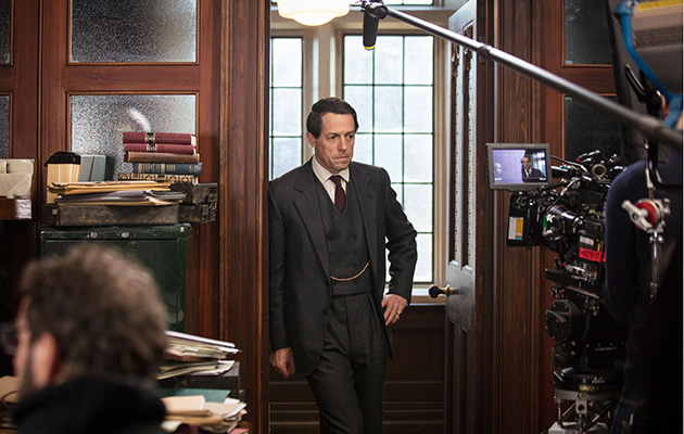 Behind the scenes shot of Hugh Grant in A Very English Scandal