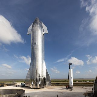 SpaceX'sfirst Starship prototype (left) stands next to one of the Falcon 1 rocket first stages at the company's South Texas site in September 2019.