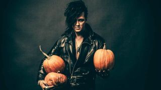 The 69 Eyes singer Jyrki 69 holding Halloween pumpkins