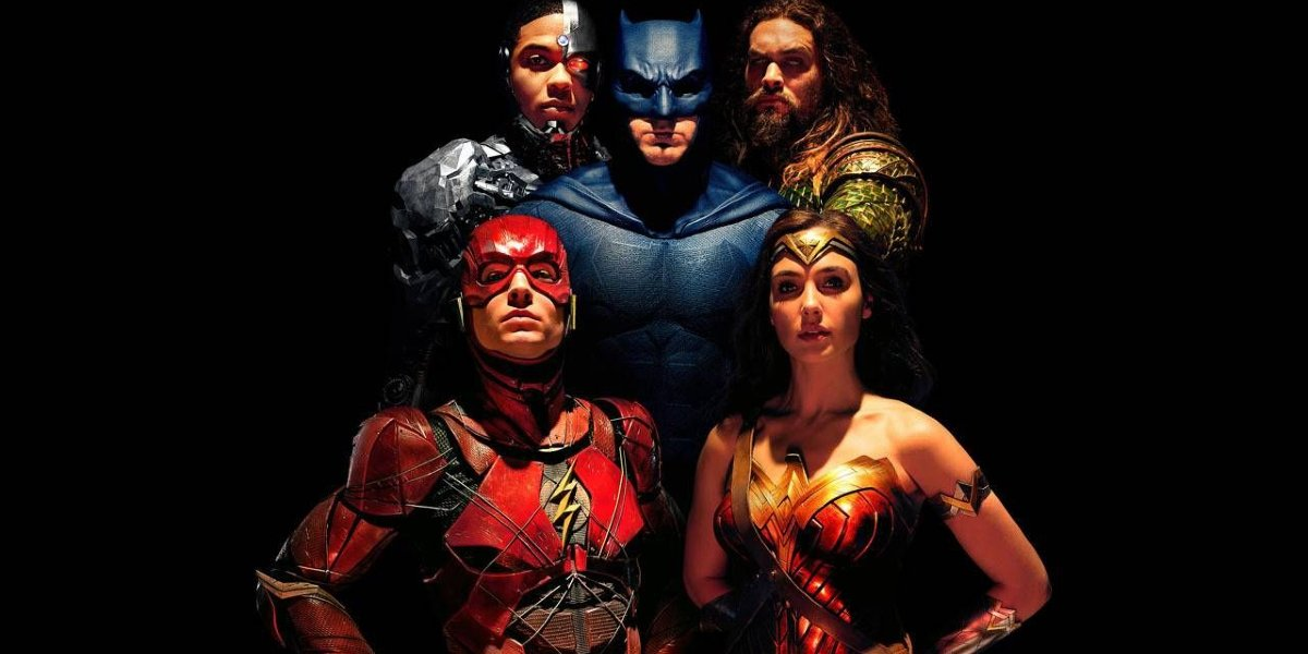 Justice League lineup, minus Superman, in the dark