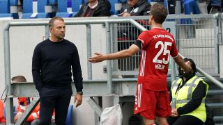 Bayern Munich's Thomas Mueller and coach Hans Flick will take on Borussia Dortmund on Wednesday in the DFL Supercup.