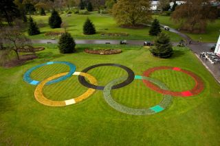 The Olympic rings rendered in flowers at London's Kew Gardens