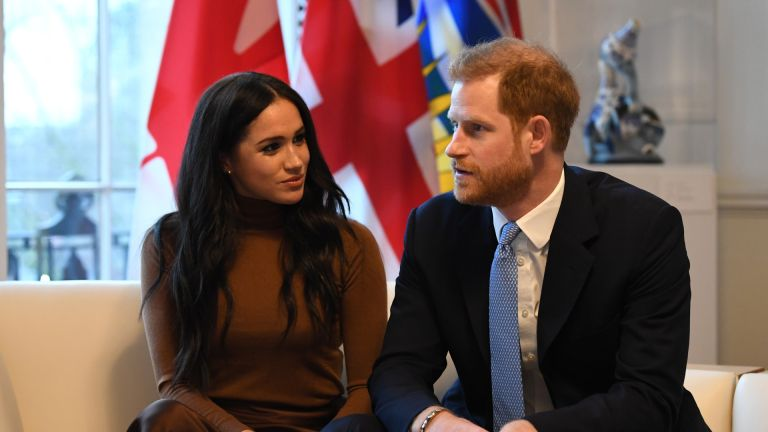 Prince Harry, Duke of Sussex and Meghan, Duchess of Sussex gesture during their visit to Canada House in thanks for the warm Canadian hospitality and support they received during their recent stay in Canada, on January 7, 2020 in London, England
