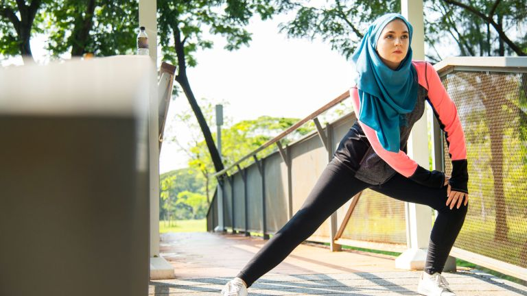 Woman in hijab doing lunges for weight loss