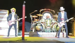 (from left) ZZ Top's Elwood Francis, Frank Beard, and Billy Gibbons perform live at at the Tuscaloosa Amphitheater in Tuscaloosa, Alabama