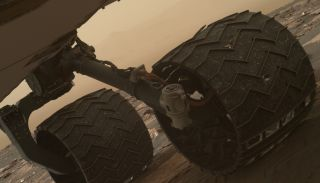 Breaks in Mars Rover Curiosity's Wheel