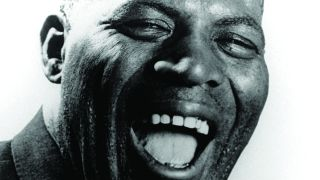 Howlin' Wolf smiling with his mouth open.