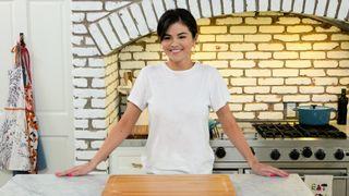 Selena Gomez standing in her kitchen