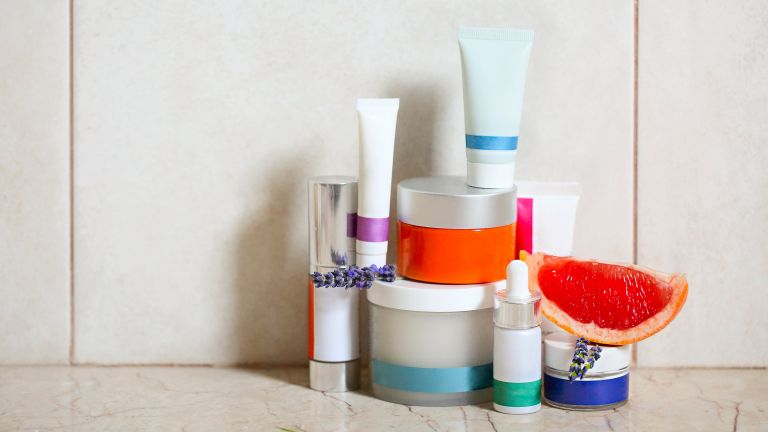 skincare prodcuts stacked in bathroom