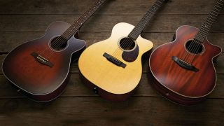 Three acoustic guitars on wood