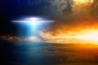 Alien spaceship in night sky clouds.