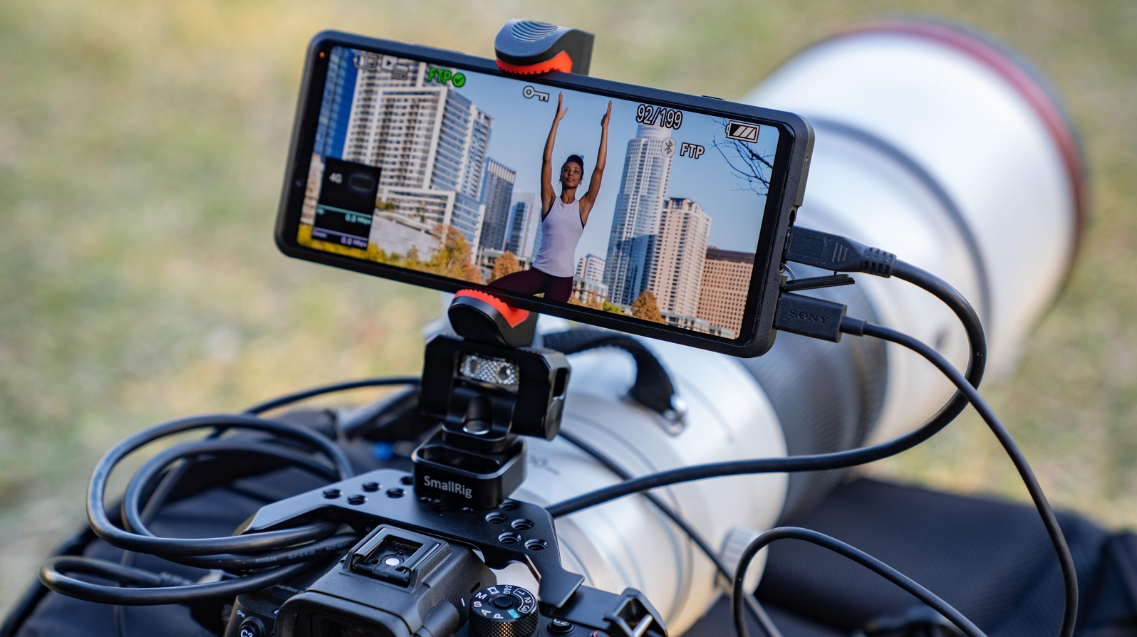 A Sony Xperia Pro mounted on top of a camera