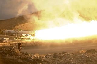The world's largest solid rocket motor fires at Orbital ATK's Utah facility in a test for NASA's Space Launch System on March 11, 2015.