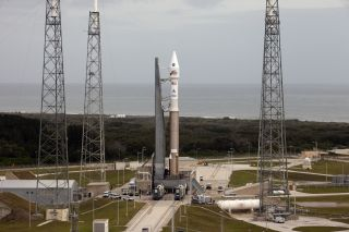 A United Launch Alliance Atlas 5 rocket stands poised to launch NASA's Mars Atmosphere and Volatile EvolutioN (MAVEN) spacecraft toward Mars from Cape Canaveral Air Force Station after being rolled out to the launch pad on Nov. 16, 2013.