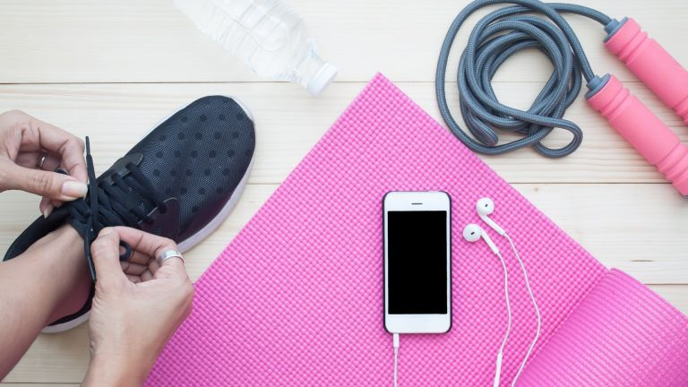 Exercise accessories including a water bottle, earphones and workout shoes