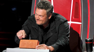 Blake Shelton holds a brick that says Ada gifted to him on The Voice