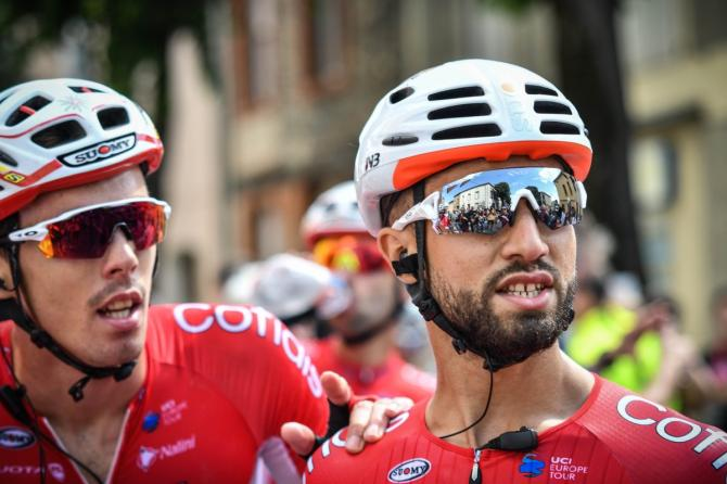 Christophe Laporte comes up to teammate Nacer Bouhanni after stage 1 of the Route d'Occitaine