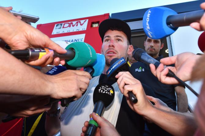Mark Cavendish talks the press before heading off to the hospital