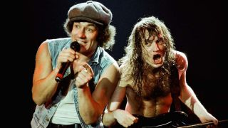 AC/DC performing their top songs on stage
