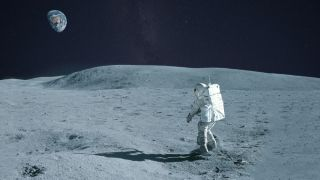 An astronaut walking across the lunar surface with Earth on the horizon.