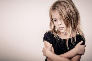A little girl looks anxious