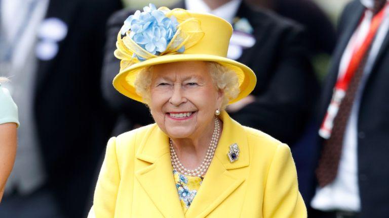 Queen Elizabeth II watches her horse 'Fabricate' run in the Wolferton Stakes