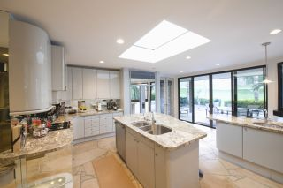 kitchen with flat roof window