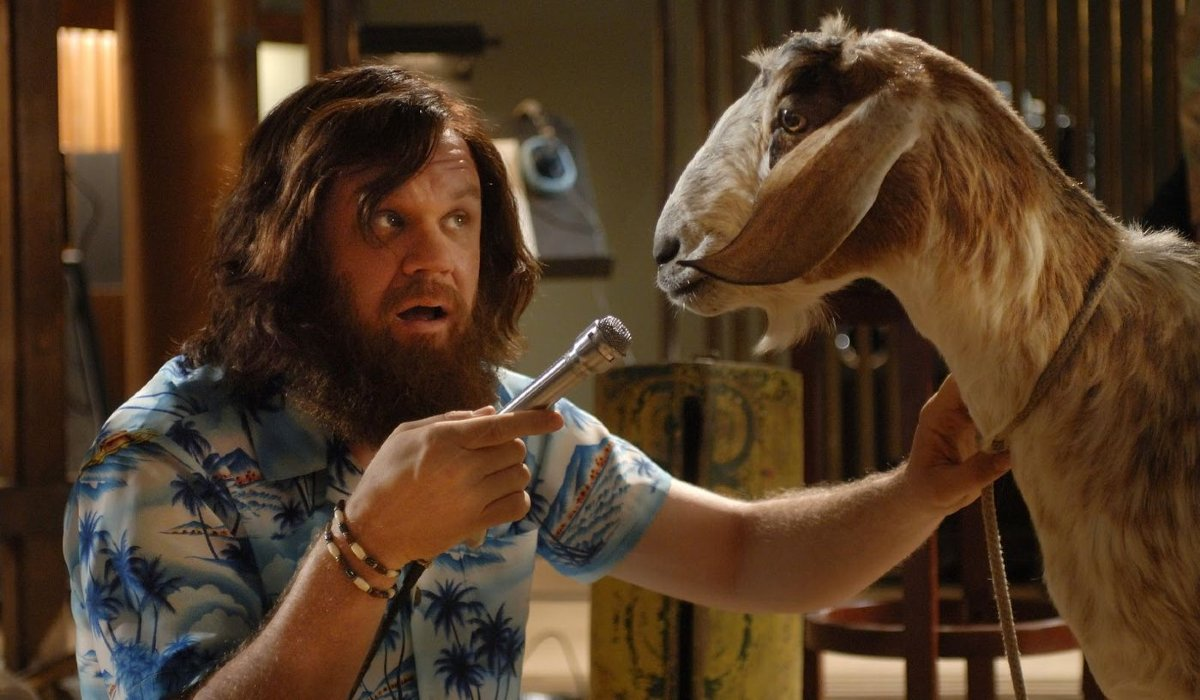 Walk Hard: The Dewey Cox Story John C. Reilly holds a mic up to a goat