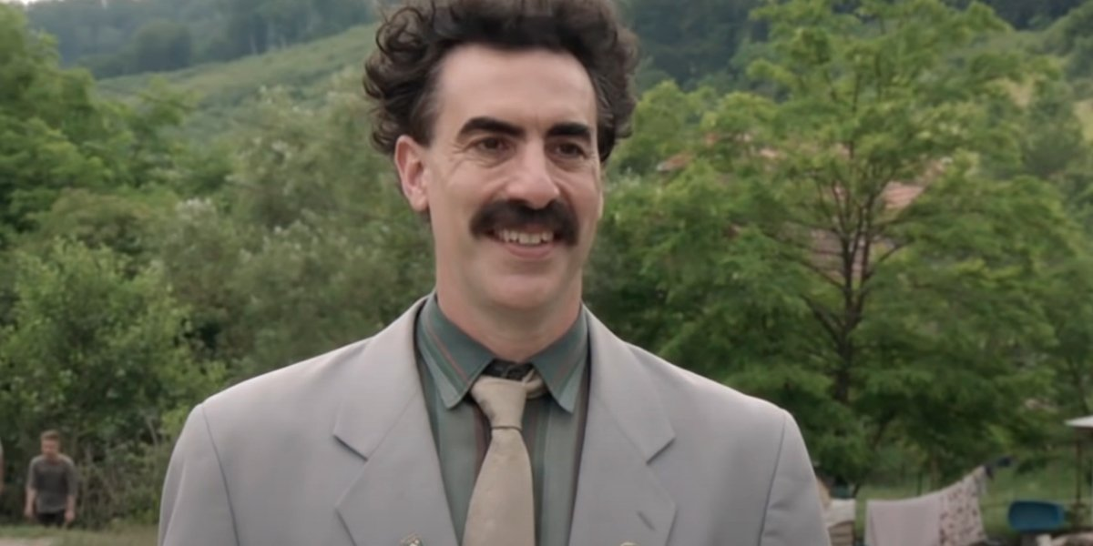 Sacha Baron Cohen as Borat in Borat Subsequent Moviefilm: Delivery of Prodigious Bribe to American Regime for Make Benefit Once Glorious Nation of Kazakhstan
