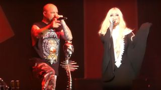 Ivan Moody and Maria Brink onstage in New Jersey