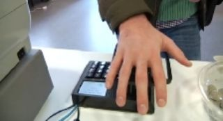 A new company uses palm scanners that identify each customer's vein pattern.