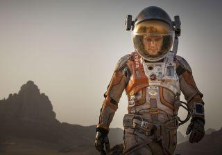 Matt Damon in a spacesuit walks on Mars