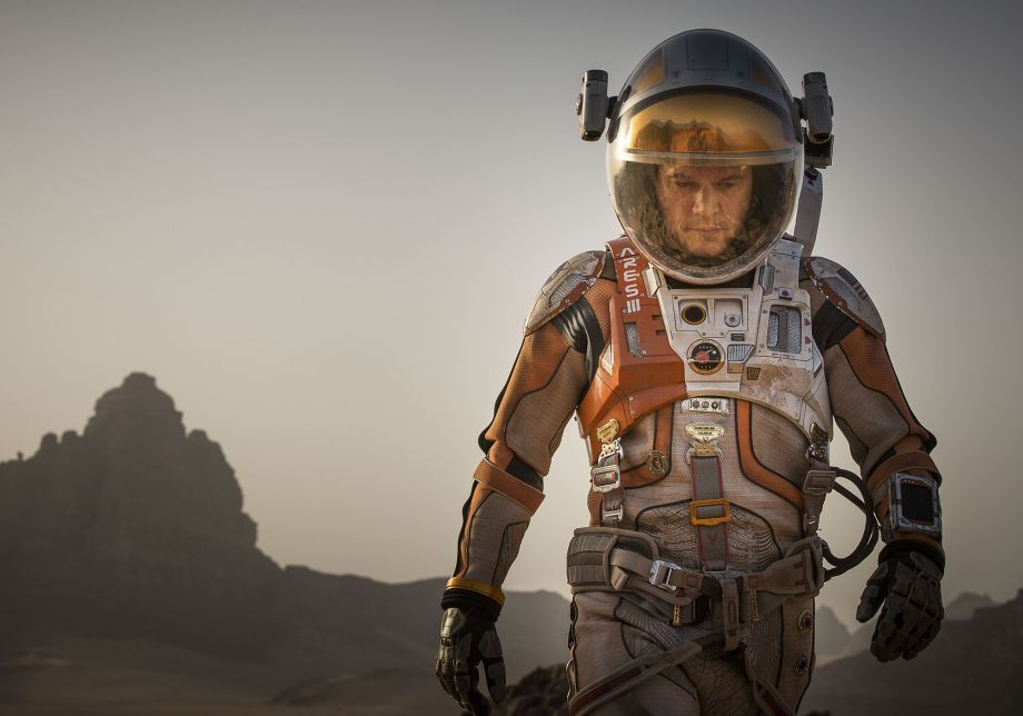 Matt Damon in a spacesuit walks on Mars