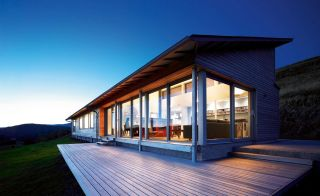 single storey self build with cladding and complementary decking