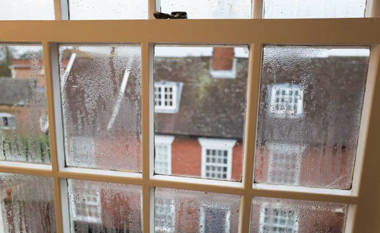 rain on a window with 6 panes