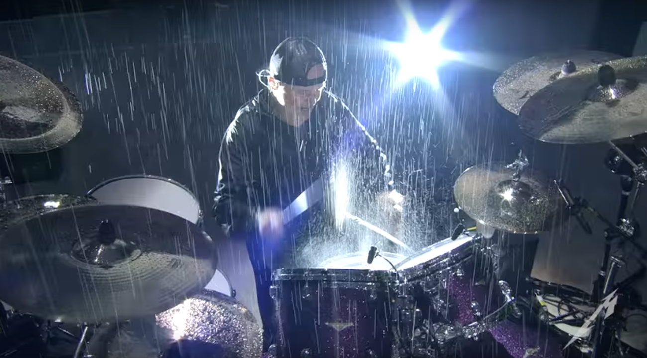 Watch Metallica get drenched Master Of Puppets in torrential rain   Louder