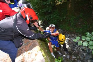Philippe Gilbert is rescued from the ravine on the Col du Portet d'Aspet in the 2018 Tour de France