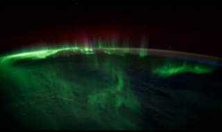 The southern lights dance over the Indian Ocean.