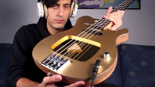 Davie504 poses with his YouTube Play Button bass guitar